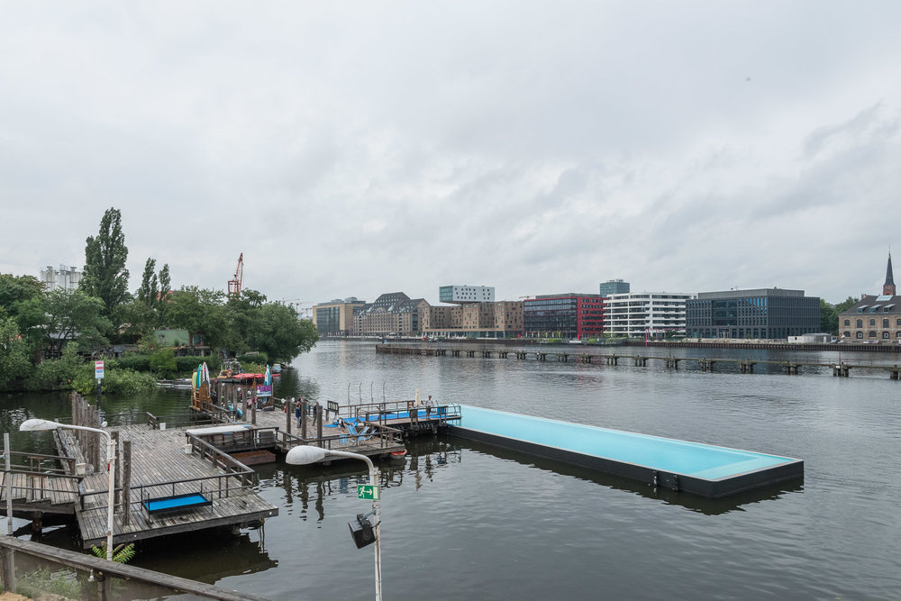 The Badeschiff in all its glory on a grey day, seen from the terrace of the club that belongs to the Badeschiff area.