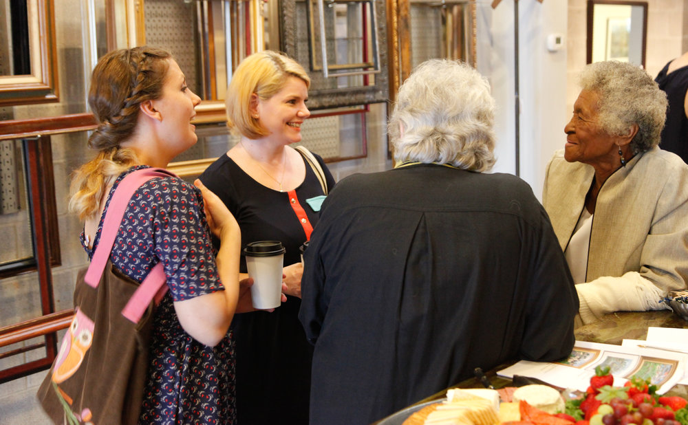Gallery guests chat and laugh with owner Kit Gilbert and Sarah.