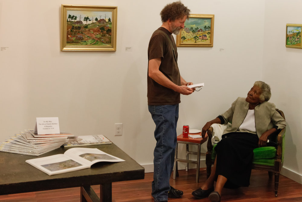 Artist Lacey Stinson, talks to one of his heroes, Ms. Sarah Albritton.