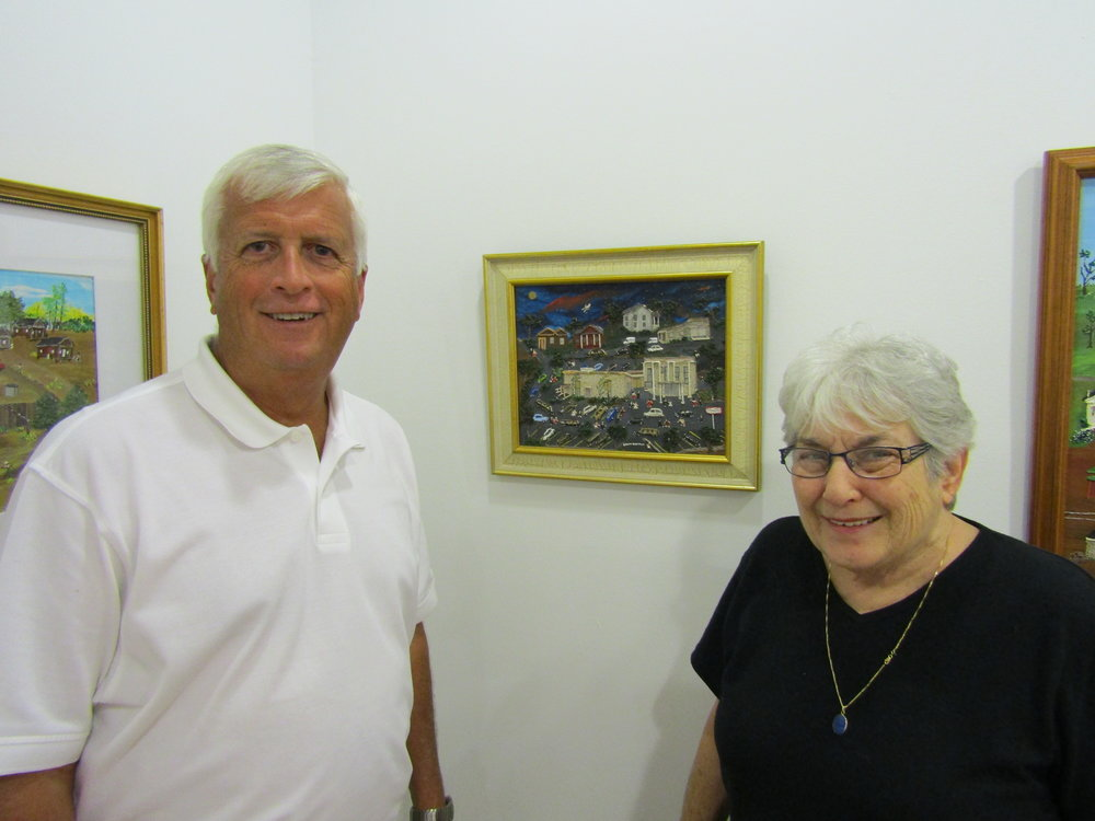 Mayor Ronny Walker and owner Kit Gilbert smile in front of Sarah's Civic Center painting.