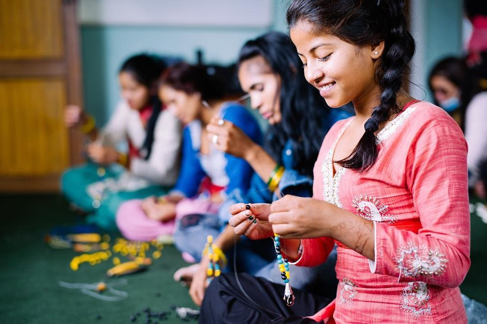 Human trafficking survivors create necklaces and braceletes at the She Has Hope Rehabilitation Center. Photo courtesy of She Has Hope.