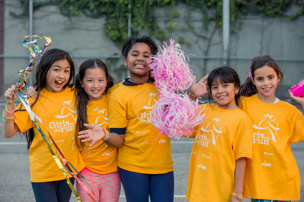 Building teamwork through dynamic activity and self-confidence through accomplishments. Photo courtesy of Girls on the Run.
