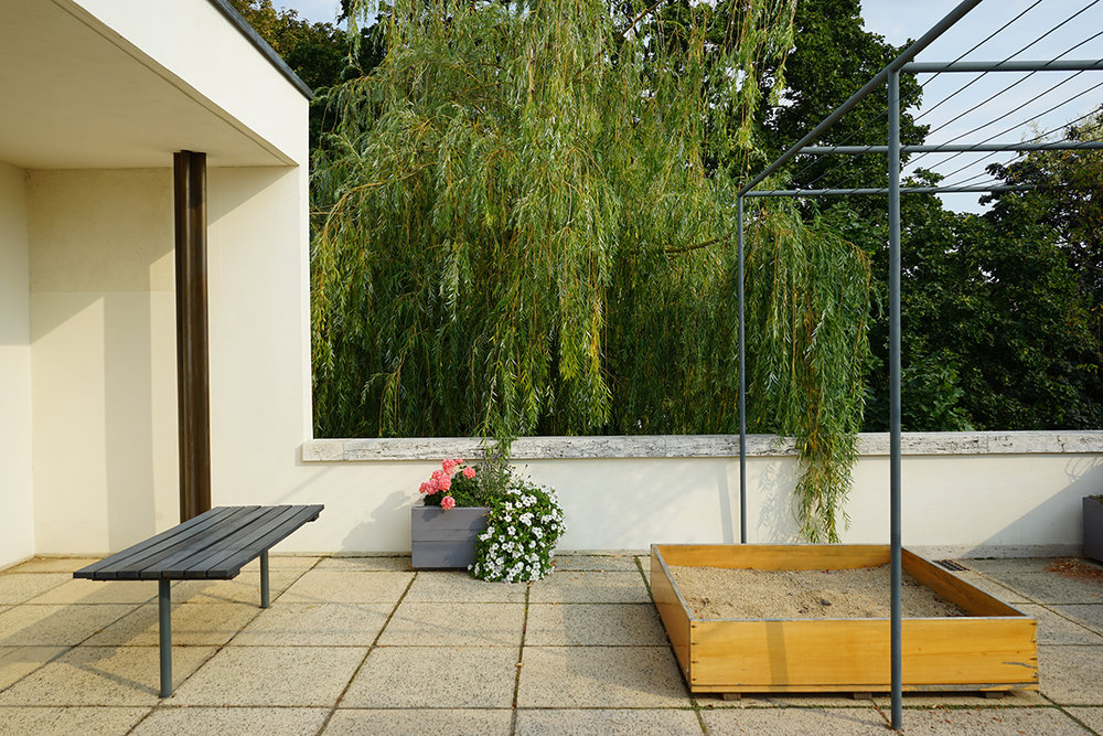 The upper terrace with sandbox at the Tugendhat House by Mies van der Rohe, where Ernst Tugendhat played in the afternoon, listening for the sound of the car horn signaling his father's arrival home.