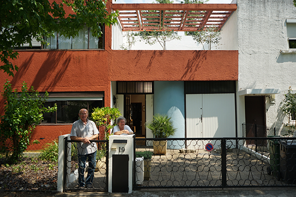 Mrs. Goron and her husband in front of their house by Le Corbusier in the Cité Frugès, Pessac where she grew up. The neighborhood reminded her of the buildings in Morocco where she lived before moving to Pessac with her family.