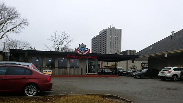 When two roofs meet in a suburban parking lot, an arcade forms.