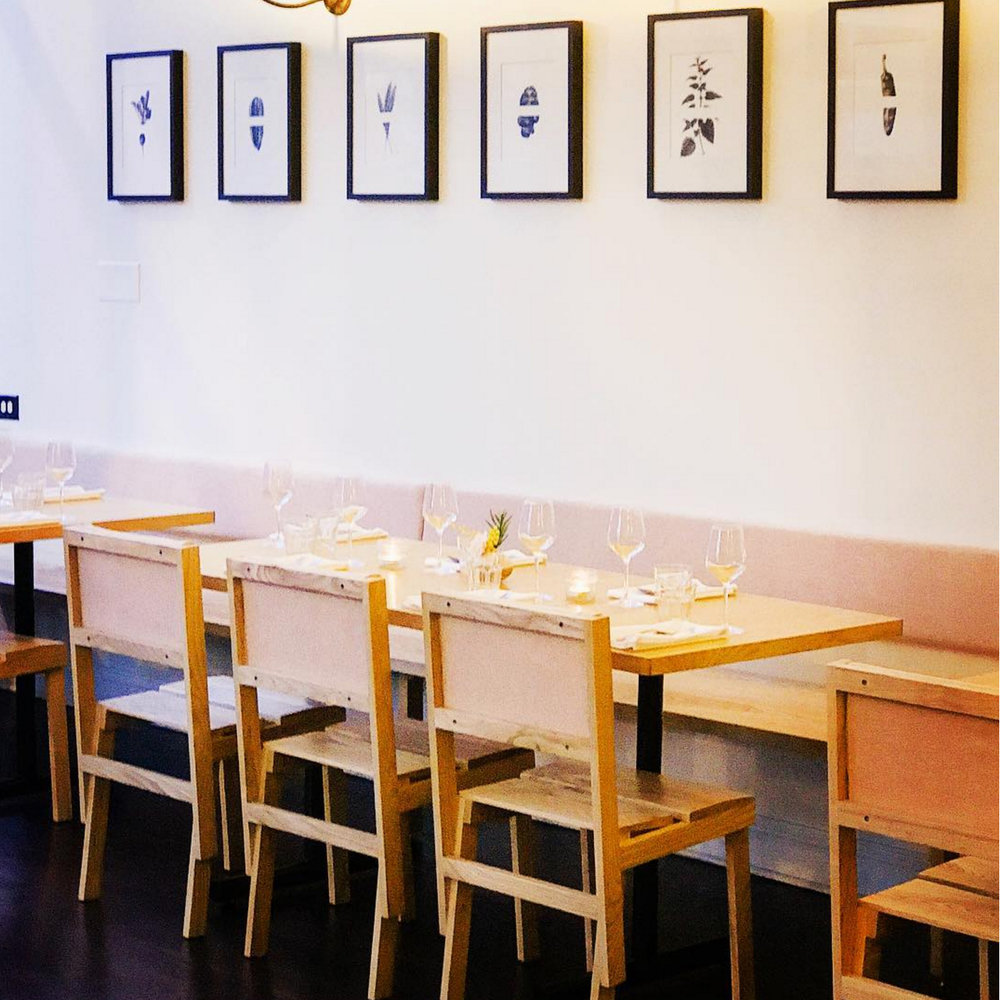 dining room chairs, tables, and banquet, set for dinner. Image courtesy Cellar Door Provisions