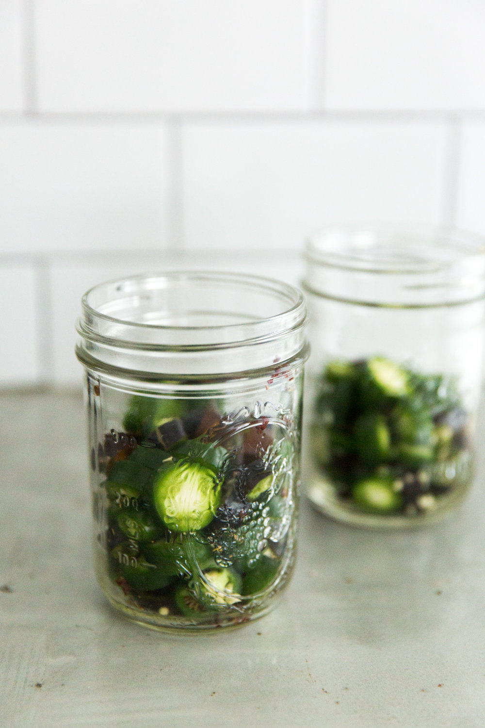 Chopped Jalapeños in jars