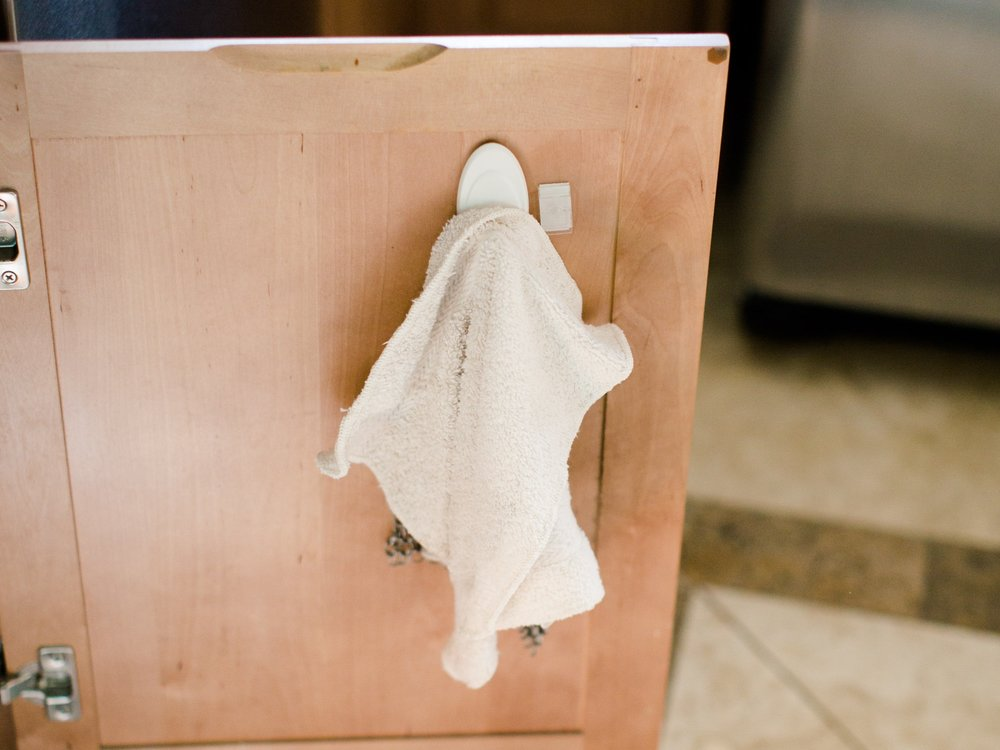 designate a towel for floor mess clean ups