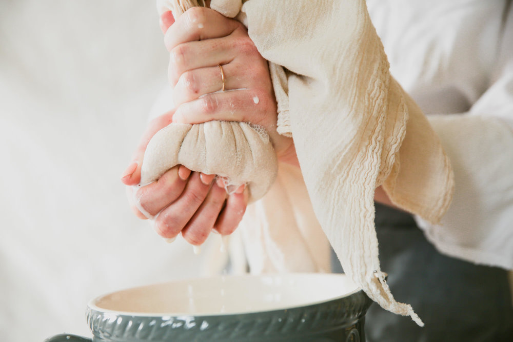 Squeezing Almond Milk Out Of Cheesecloth