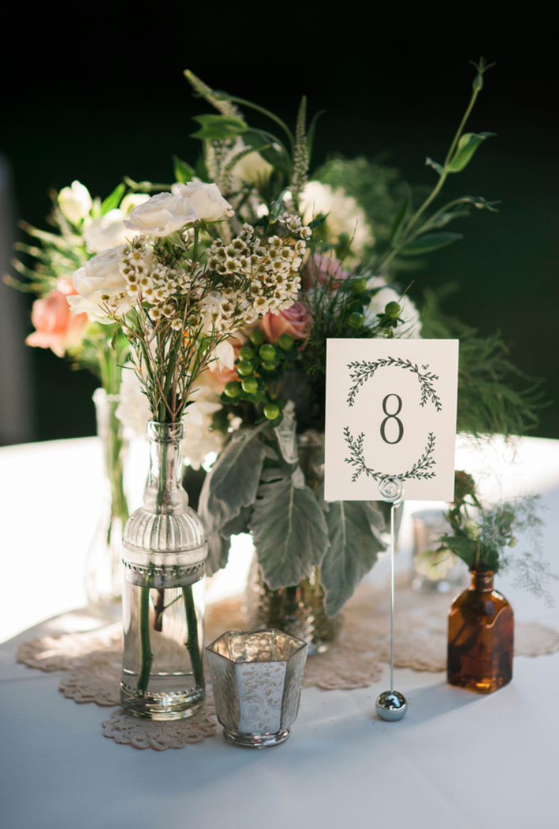 Table numbers designed to match the wedding logo