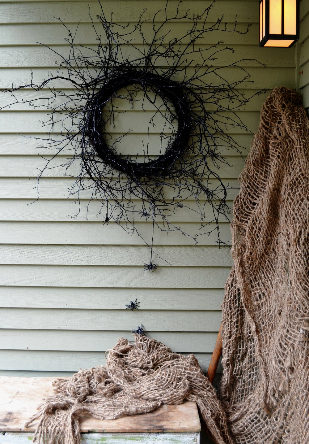 A friend and I went out into the woods and got some vines, cut them down and wrapped them around a wooden floral form with wire. Then I sprayed it all black and hung some plastic spiders off of it...Seriously simple! Halloween wreaths...gotta love it!