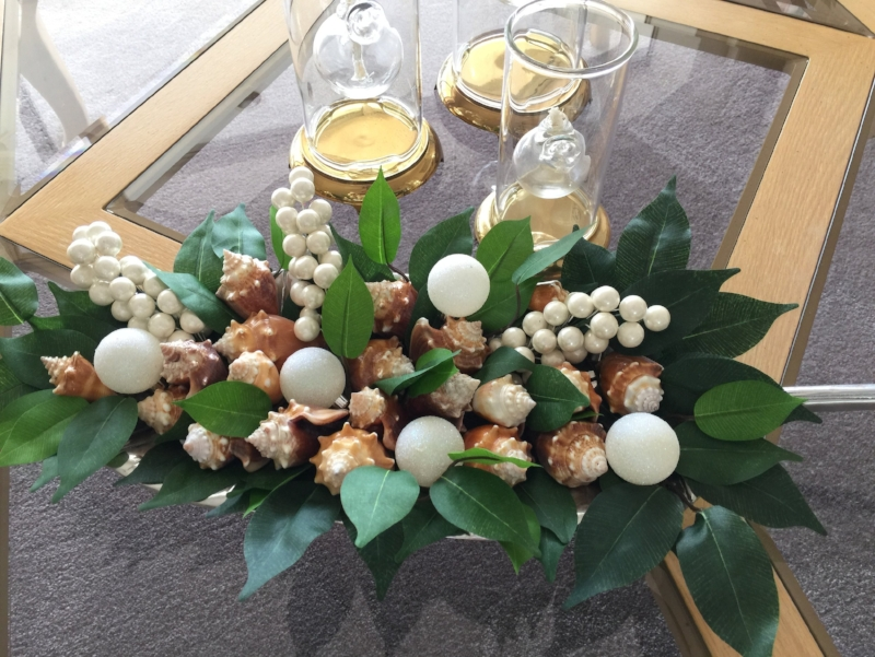 On my trip to Florida a couple of weeks ago, my Mom and I went shell hunting.  We could not believe our luck when we found all these (it was after the super moon...). Add some faux leaves and berries and created a fun Christmas table display for her Florida home.