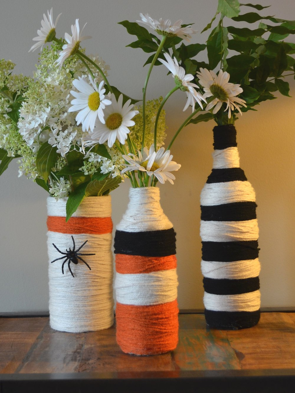Halloween Vases for a party! Just add yarn (and a fake spider or two).