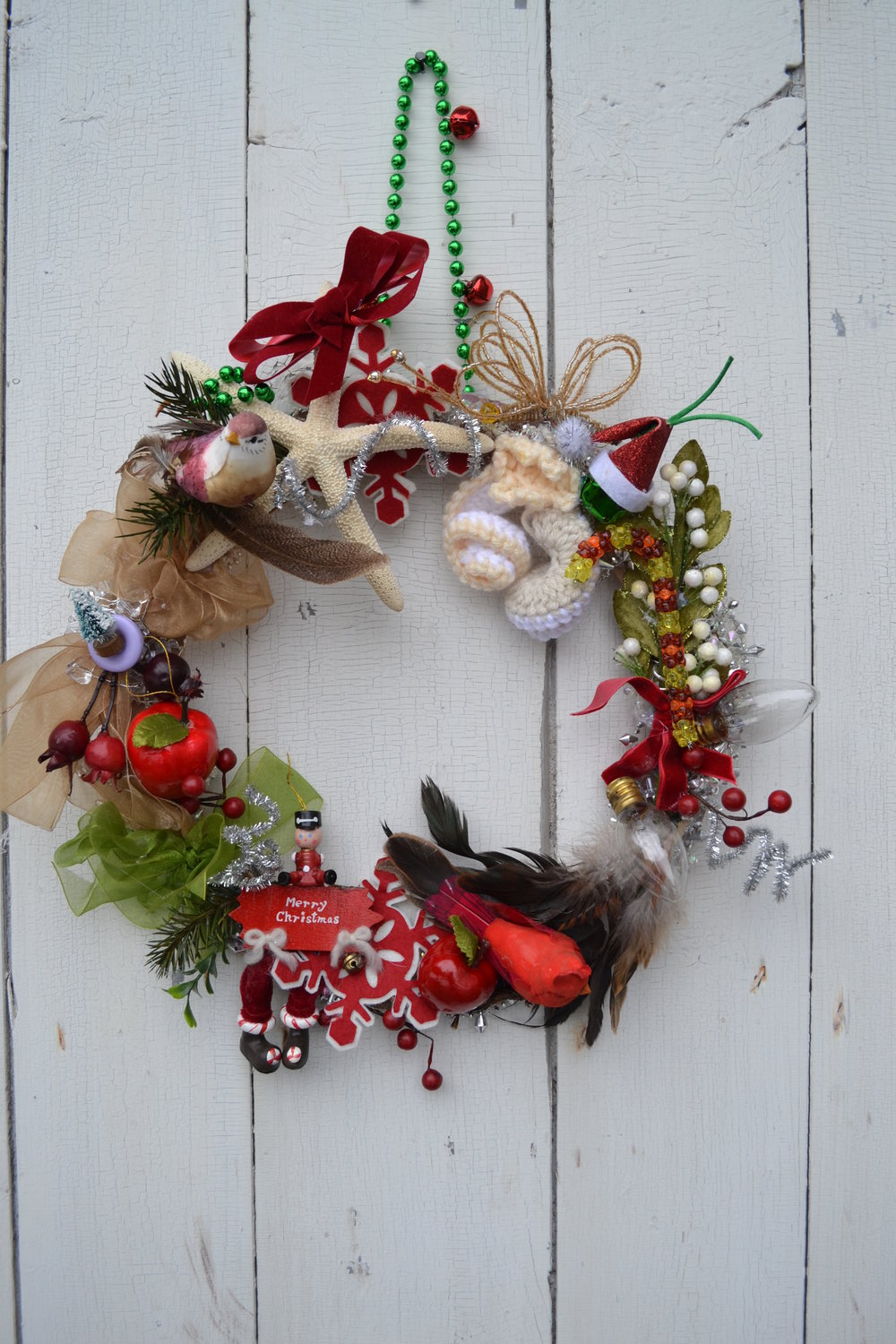 I call this my wreath of Misfit Toys…I found all the broken ornaments, holiday bulbs, left over stuff from wrapping paper and ribbons and glued it all onto a wood floral frame. I'm sure you don't even have to leave the house to make this. Make a cardboard ring if you don't have a wooden one.