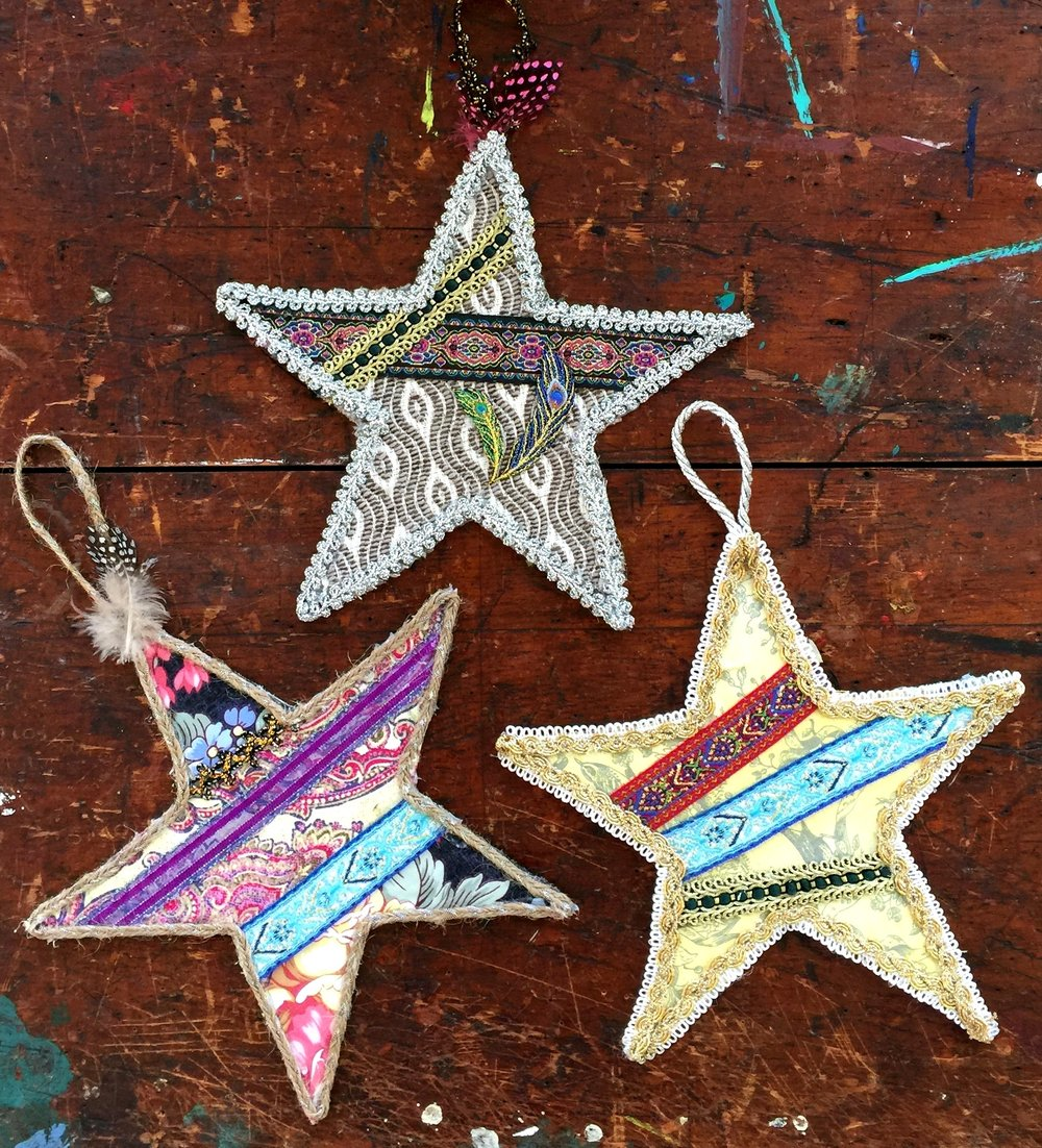 Hanging Fabric and Ribbon Bohemian Stars. Cardboard, Scissors, Scraps of Ribbon and Fabrics. You can make lots of shapes…Hearts, Crescent Moons, Fish…  HOW TO DIY NETWORK