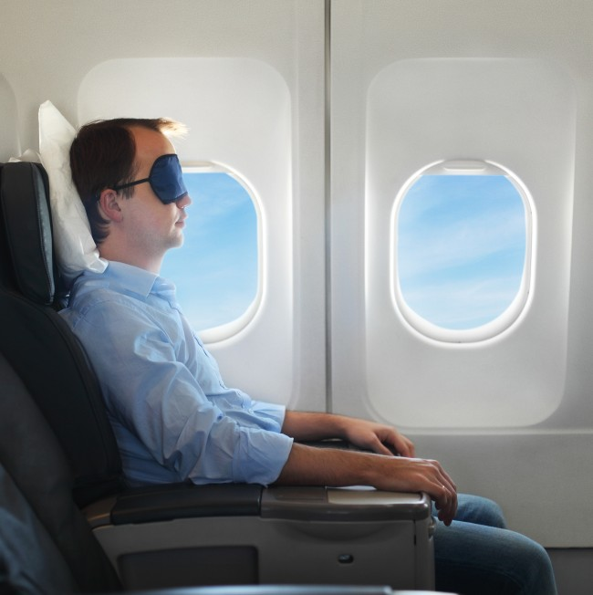 sleeping-on-plane-shutterstock_119470189_large-e1429041719441.jpg