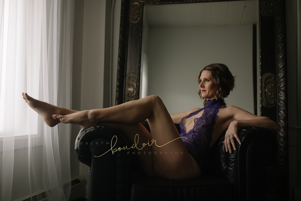 Purple Victoria's Secret bodysuit | Jen at Duluth Boudoir Photography in Minnesota | Black tufted chair in front of wall mirror