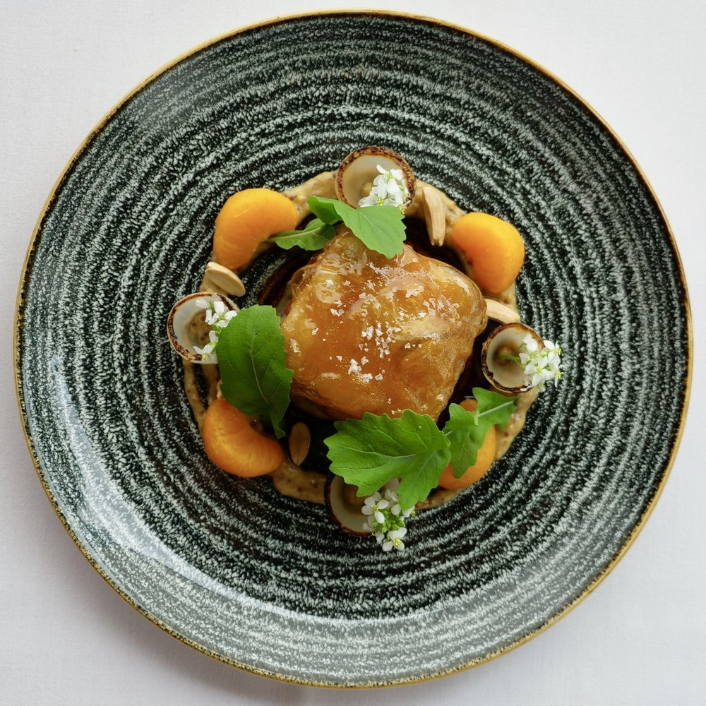 BYRON BAY BERKSHIRE PORK CHEEK, MANDARIN, FIERY MUSTARD, CHARRED ONION, GARLIC MUSTARD, ALMONDS.
