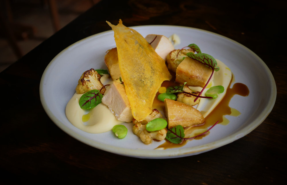 ROASTED BREAST OF FREE RANGE CHICKEN, CAULIFLOWER PUREE, BROAD BEANS, RED VEIN SORREL.