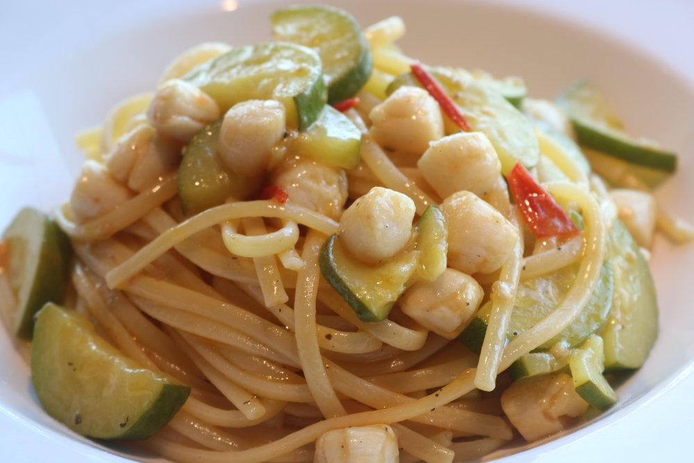 Pan cooked scallops, zucchini and cherry tomatoes served with linguine pasta.