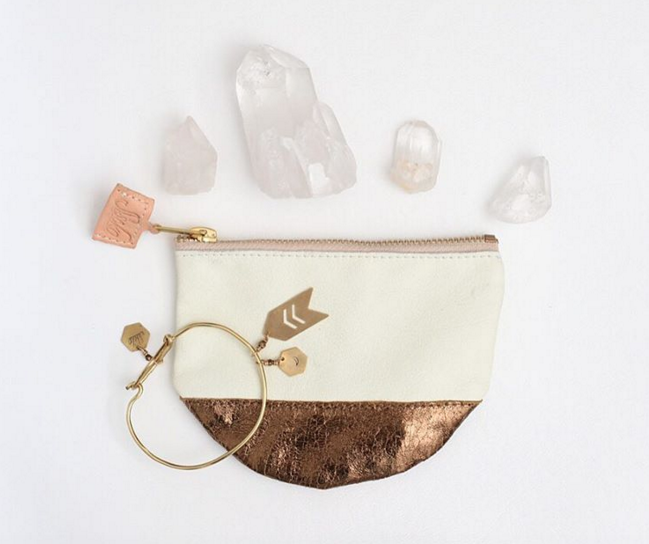 Photo from Sseko Designs Instagram / Large White & Gold Moon Clutch