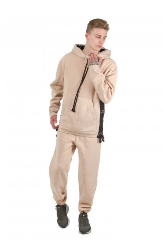 Sand DuneTrack Suit by Fusion Clothing - This neutral tone hoodie and track pants are the ideal track suit for anyone looking to rock some athleisure this winter. Not only does it scream Americana, but the side-vent details on the hoodie make this set something you'll never find anywhere else. Pair it with the puffer or your favorite denim Trucker Jacket and you're well on your way to becoming a streetwear icon.