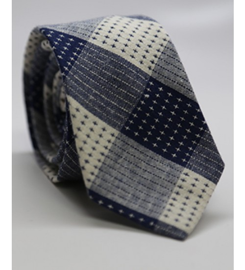 Blue Quilt NecktieHarrison Blake Apparel$18.00 - This is definitely not your average tie. This Blue Quilted Necktie, by Harrison Blake Apparel, will add a touch of personality to your outfit. Pairing this tie with the white shirt and navy pants will totally bring the look together.