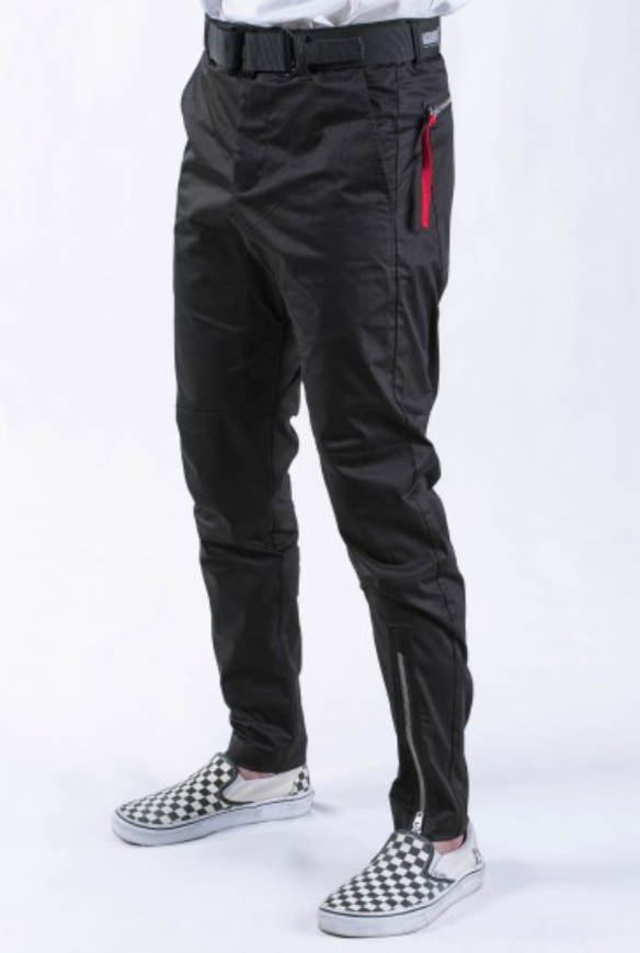"""Substratum Asymmetry Pant – Idle/Idō - This pant is, to quote Lana del Rey, fresh to death and sick as cancer. Featuring an asymmetrical detail, perfect tapering, and subtle streetwear elements, including a shout out to Alpha Industries and its infamous """"Remove Before Flight"""" tag, this pant is perfection. Your friend will be sure to make this their next favorite closet staple and, since the pant is black, it matches with everything and can add necessary detail to an all-black outfit."""