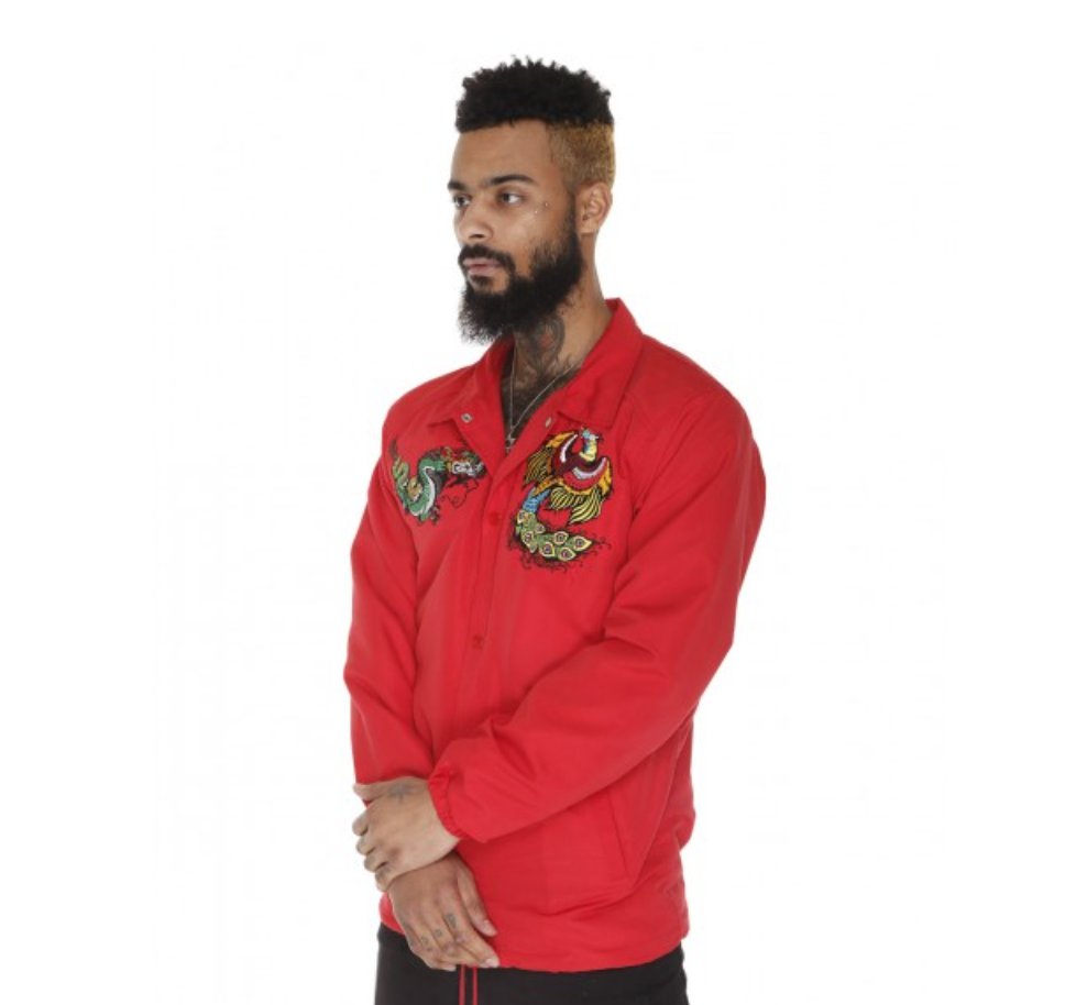 - As if the rich red isn't enough, the depth and rich colors used to create the embroidery make this Coaches jacket one of a kind. Made of 100% cotton, this jacket is perfect for that fall to winter transition. The highlight of this piece is the beautiful embroidery on the two front panels and the back, which can be seen frequently on pieces from Iridum Clothing Company.