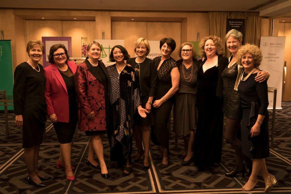 Past Presidents of Australian Women Lawyers (L-R): Audrey Mills (Tas), Dominique Hogan-Doran SC (NSW), Jennifer Batrouney QC (Vic), Noor Blumer (ACT), Judge Caroline Kirton (Vic), Fiona McLeod SC (Vic), Mary Anne Ryan (Tas), Rebecca Lee (WA), Elspeth Hensler (WA), Ann-Maree David (Qld) (absent: Alexandra Richards QC (Vic), Kate Ashmor (Vic), Olivia Perkiss (Qld)).