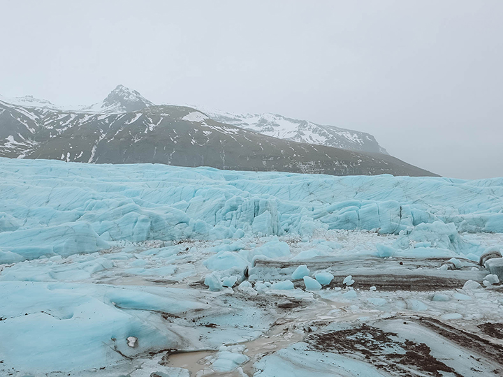 Svinafellsjokull Glacier - we saw the bright blue glacier from afar and although it wasn't on our itinerary (why didn't anyone tell us about this?), we made a left turn onto a dirt road and came across one of my favorite places of our entire trip.