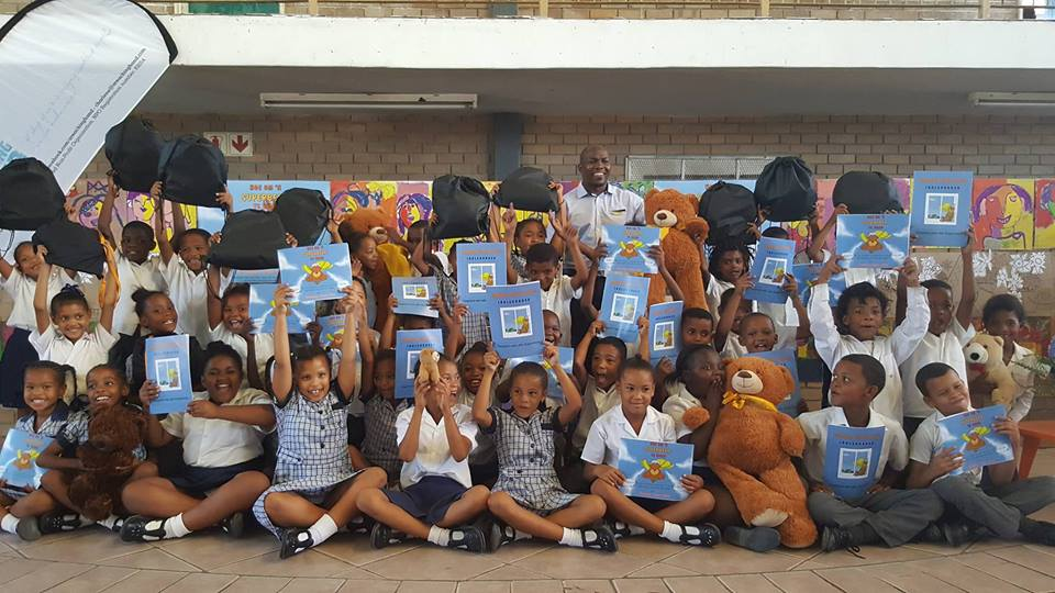 "The wonderful Deputy Principal Mr Twalo with the GR 1 & Gr 2 learners who are extremely excited to get a education package of ""Hoe om 'n Superbeer te word"" (How to be a Super Bear""!"