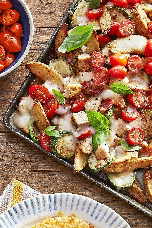 Loaded Potato Nachos - 1 (24-oz.) package frozen rosemary garlic oven fries, or regular fries1 sliced zucchini3 slices chopped bacon2 (8-oz.) boneless, skinless chicken breasts1 tsp. Italian seasoningKosher salt and black pepper2 tbsp. olive oil1 1/2 c. shredded Italian five-cheese blend1 pt. Grape tomatoes, halved1 Chopped Garlic Clove2 tsp. balsamic vinegar1/3 c. Torn fresh basil leaves