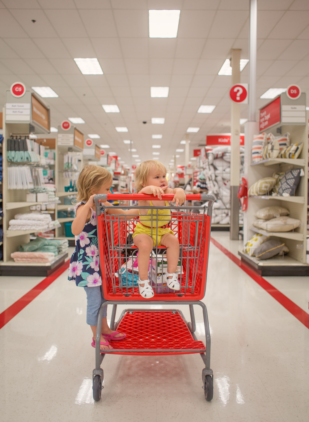 04 young girls target shopping cart edmond oklahoma photographer lifestyle portrait (1).png