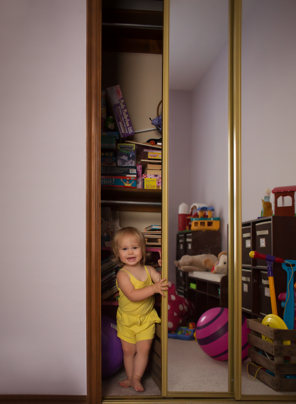 11 toddler girl peek a boo closet mirror play room house edmond ok photographer lifestyle portrait.png