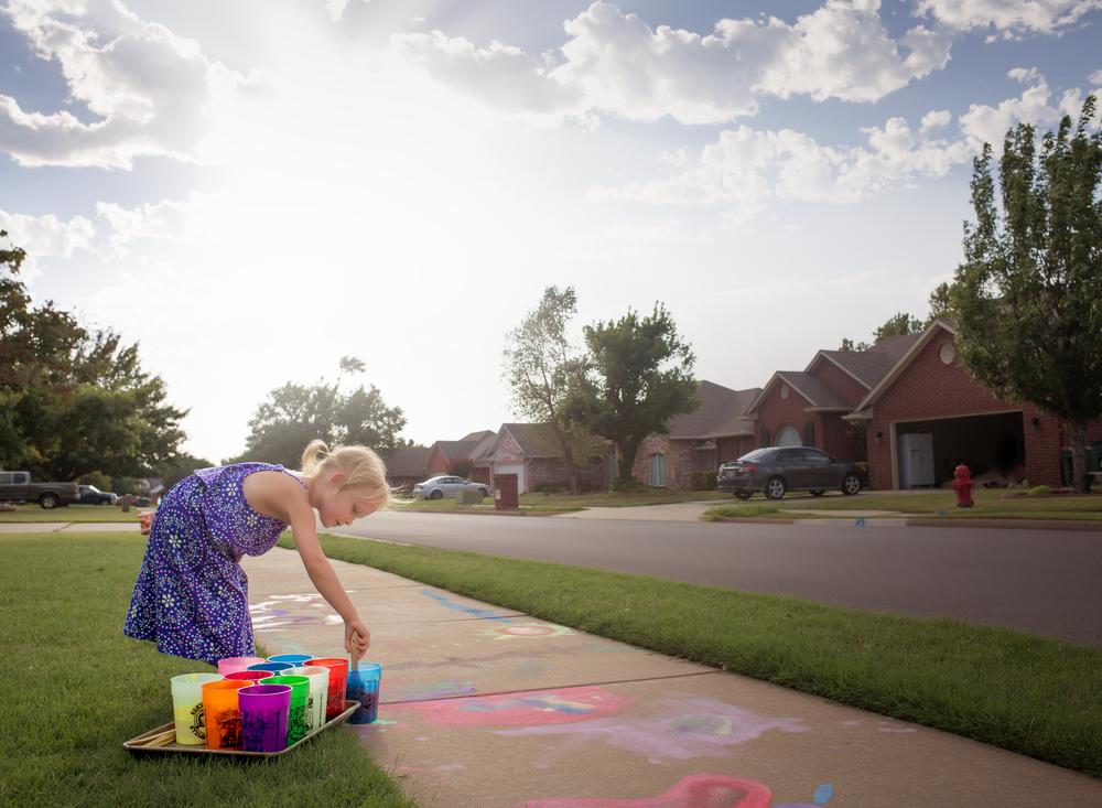 09 the world is her canvas girl purple dress sidewalk chalk paint neighborhood edmond ok oklahoma city photographer (3).png