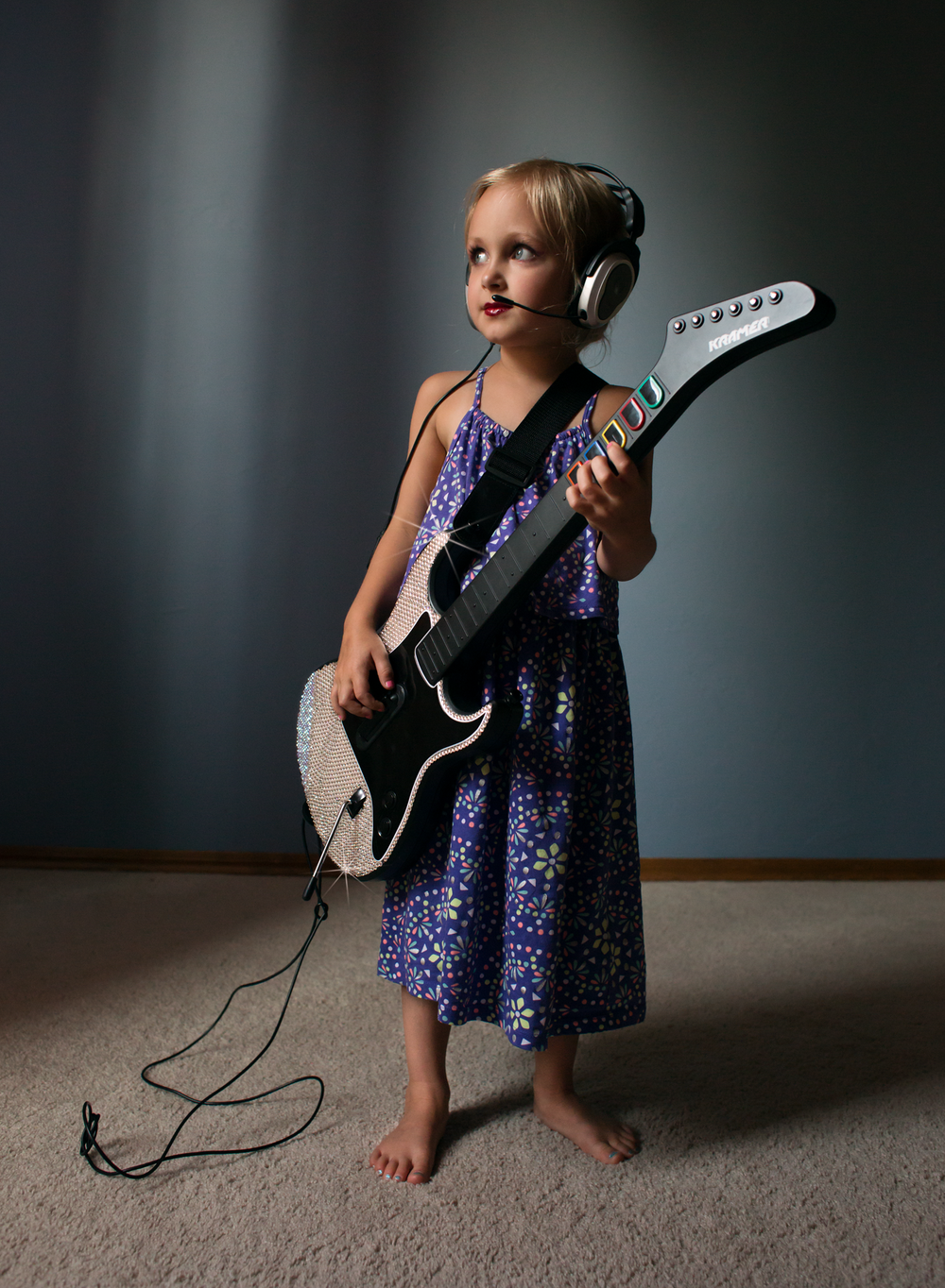 04 little rocker girl playing bling guitar hero headset lifestyle natural light edmond ok photographer oklahoma city (1).png
