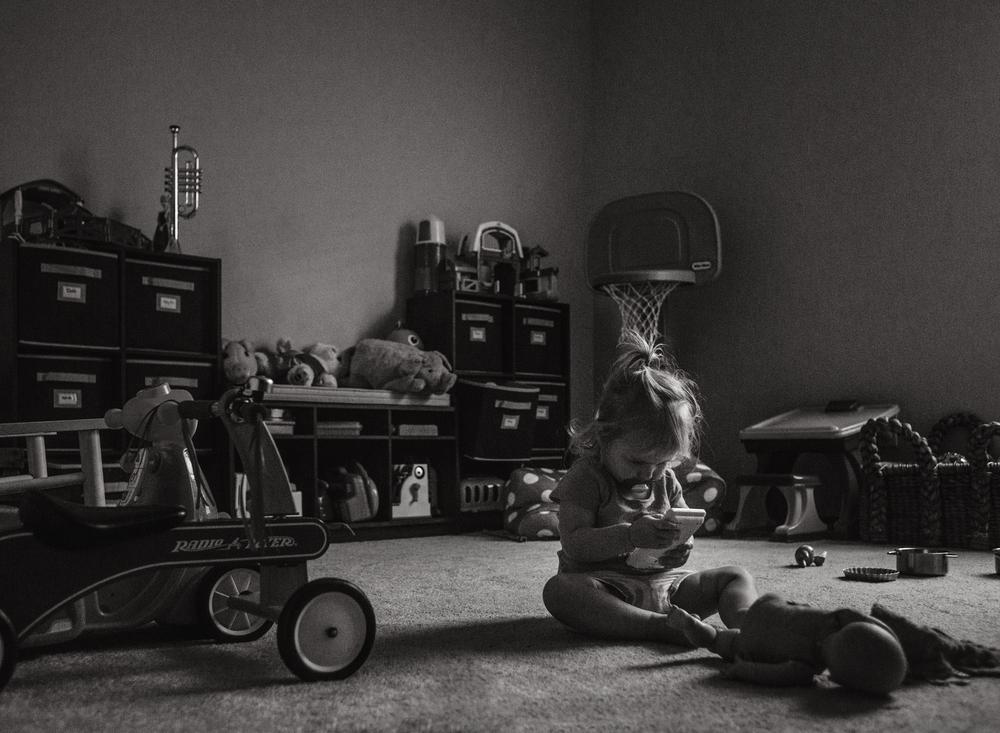 04 alone time black and white toddler playroom window light lifestyle edmond ok photographer
