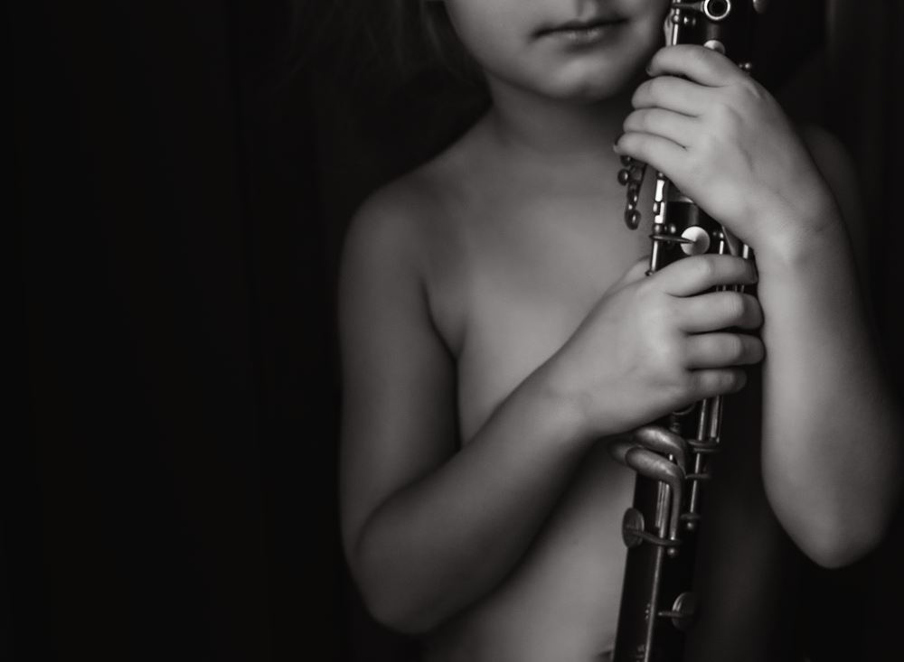 02 mom's clarinet black and white child musical instrument window light edmond ok photographer oklahoma city natural light (1).png
