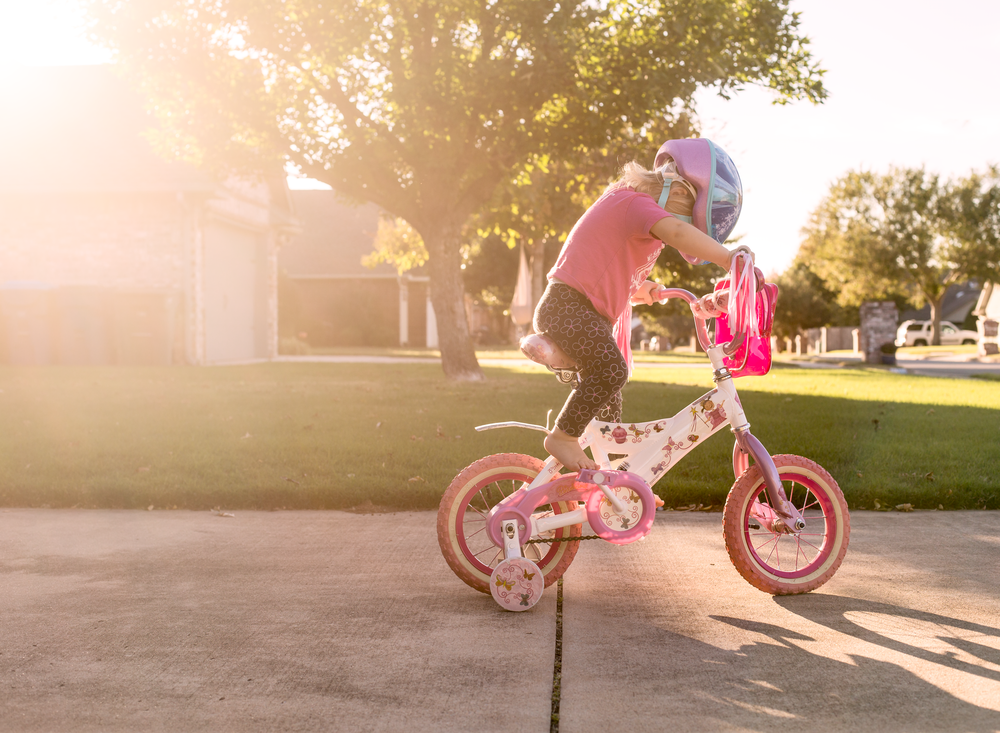 03 when sister's away toddler girl riding sister's bike pinkalicious bicycle disney frozen bike helmet suburband neighborhood sidewalk edmond ok photographer oklahoma city lifestyle natural light (5).png