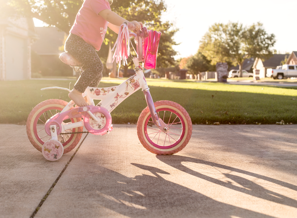 03 when sister's away toddler girl riding sister's bike pinkalicious bicycle disney frozen bike helmet suburband neighborhood sidewalk edmond ok photographer oklahoma city lifestyle natural light (3).png