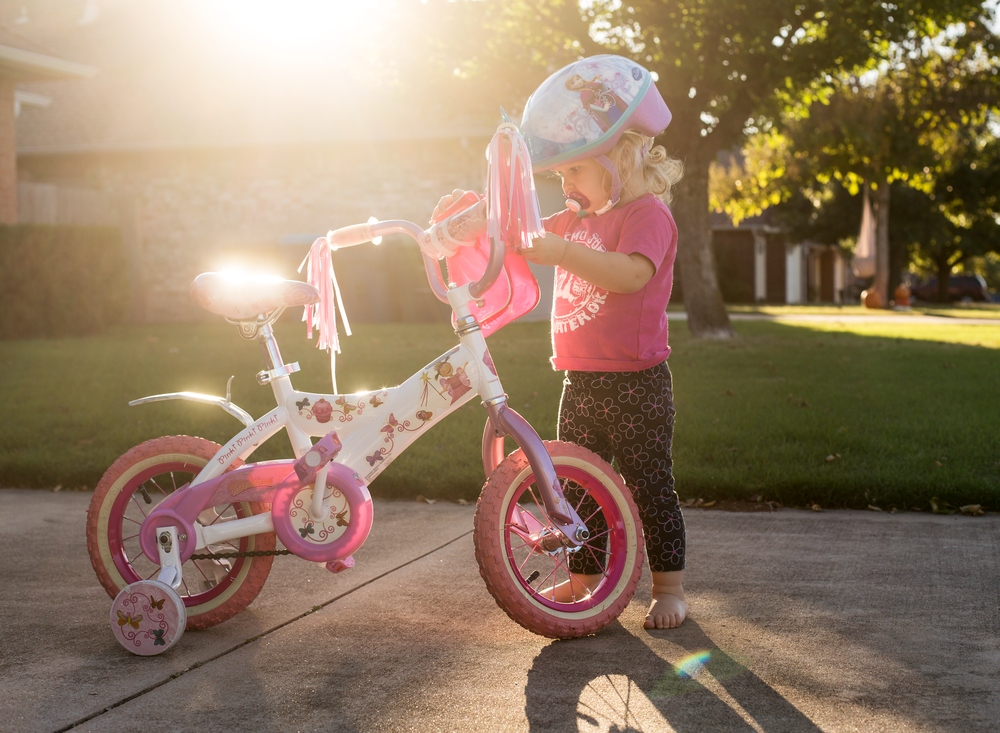 03 when sister's away toddler girl riding sister's bike pinkalicious bicycle disney frozen bike helmet suburband neighborhood sidewalk edmond ok photographer oklahoma city lifestyle natural light (7).png