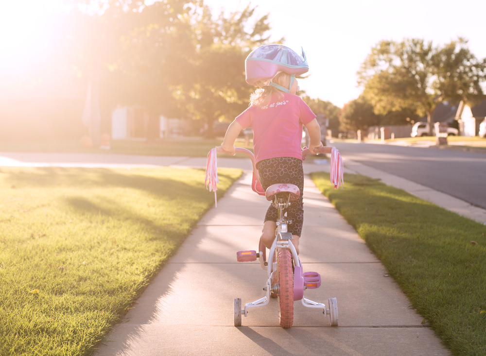 03 when sister's away toddler girl riding sister's bike pinkalicious bicycle disney frozen bike helmet suburband neighborhood sidewalk edmond ok photographer oklahoma city lifestyle natural light (13).png