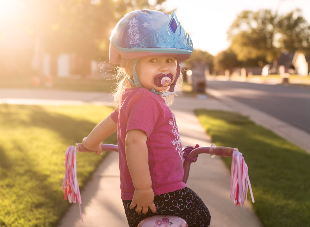 03 when sister's away toddler girl riding sister's bike pinkalicious bicycle disney frozen bike helmet suburband neighborhood sidewalk edmond ok photographer oklahoma city lifestyle natural light (15).png