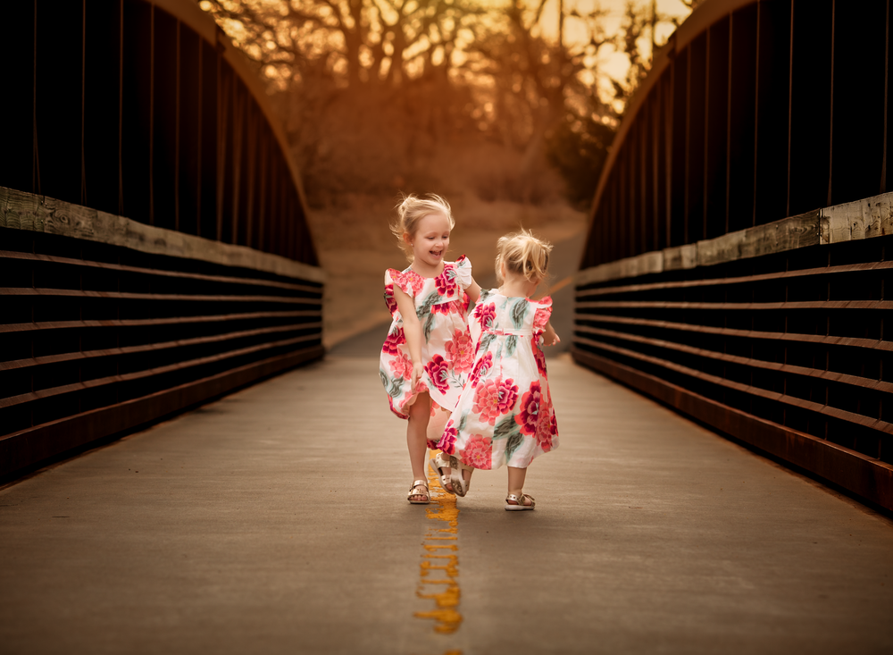 01 sisters in spring children tea collection dress siblings backlight golden hour natural light portrait edmond ok photographer oklahoma city kate luber photography (2).png