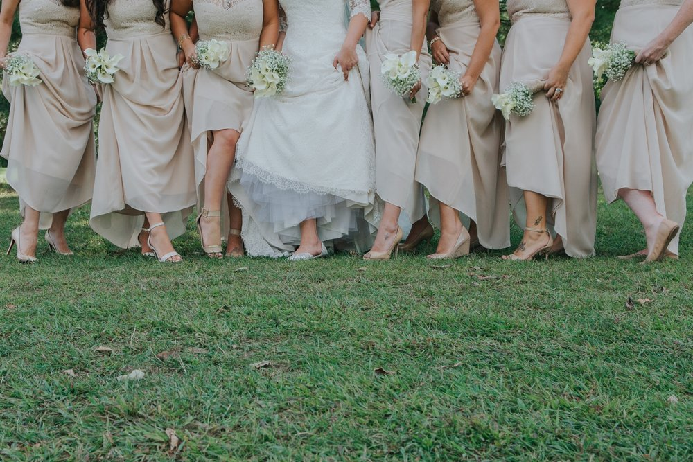 bridal party showing shoes and flowers
