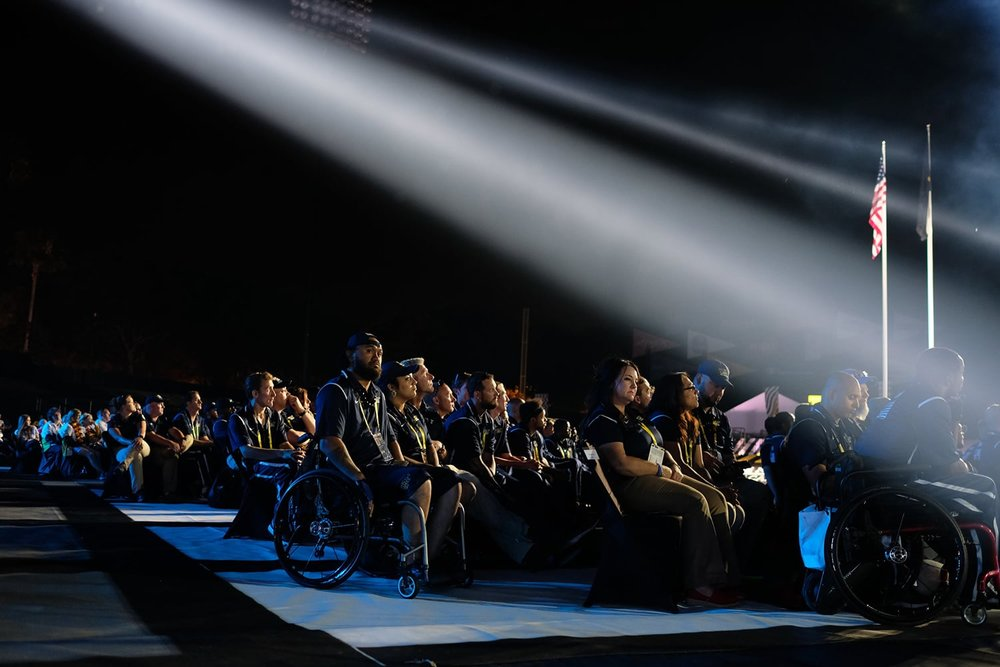 Invictus athletes listening to stage program during the Opening Ceremonies of the 2016 Invictus Games at the ESPN Wide World of Sports Complex in Orlando, Florida, May 8, 2016. The Invictus Games is an international adaptive sporting event for wounded, injured, and ill service members and veterans. (Official White House Photo by Chuck Kennedy)