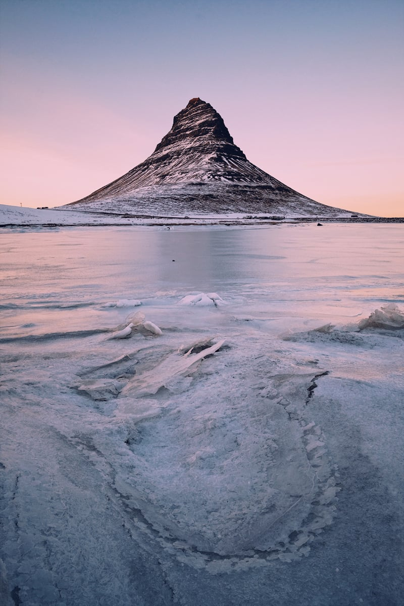 Sunset at Kirkjufell The last time I was here in Nov 2016 we had to get mentally prepared for the wind and rain. Run around the back of the waterfall and grab a quick photo with the Kirkjufell barely visible through the dense fog. What a difference a few months make. Time to wander around the whole area and make the most of the amazing ice patterns and this iconic mountain with a beautiful glow from the sunset.