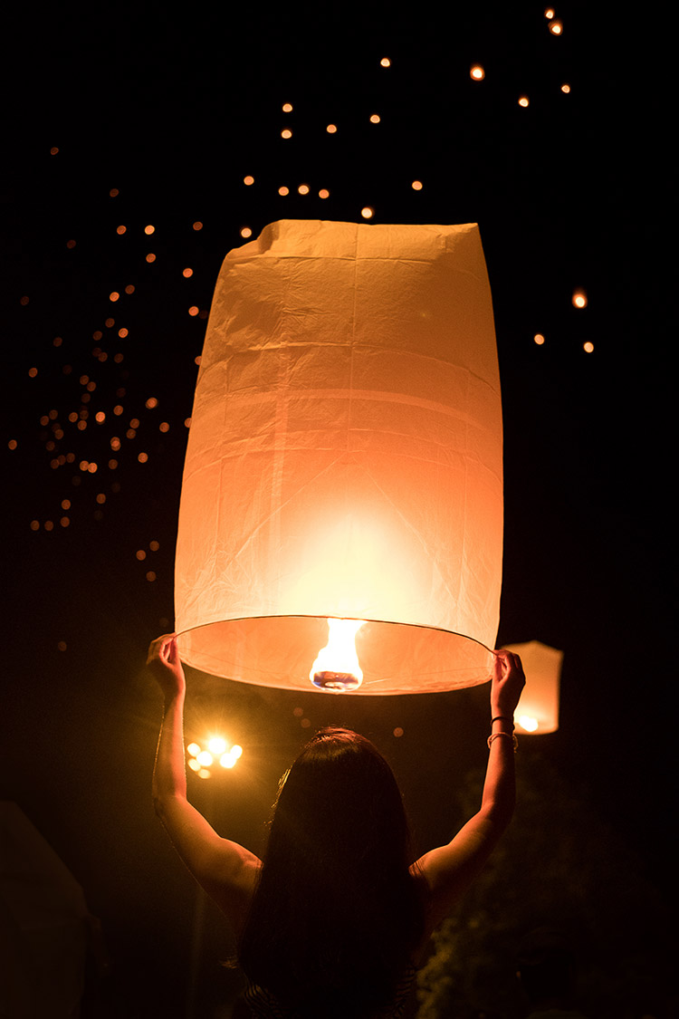 Lighting New Year's lanterns in Chiang Mai, Thailand