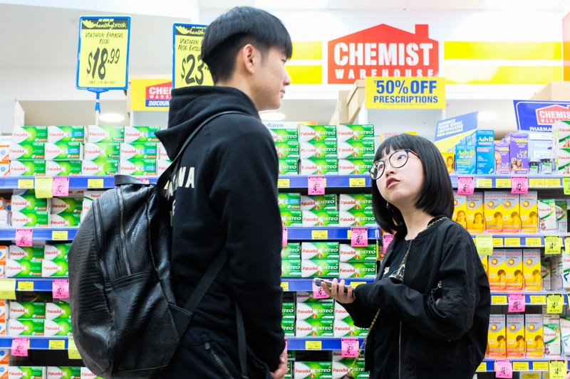 Customers at the Chemist Warehouse stand in front of the paracetamol isle. Being a daigou is a popular part time occupation for international students from China due to both convenience and the potential to earn good money whilst easing the financial burden on their parents back home. Asanka Brendon Ratnayake for The New York Times